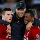 Liverpool's Andrew Robertson and Georginio Wijnaldum celebrate with manager Juergen Klopp after the match REUTERS/Phil Noble