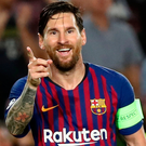 Barcelona's Lionel Messi celebrates scoring their fourth goal to complete his hat-trick against PSV Eindhoven. Photo: Reuters