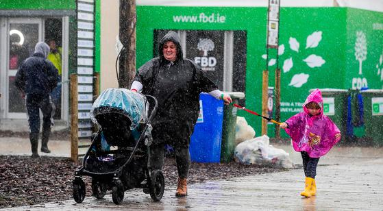 A sudden downpour yesterday gives visitors to the National Ploughing Championship in Tullamore a drenching. Photo: PA