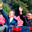 South Korean President Moon Jae-in and North Korean leader Kim Jong Un wave during a car parade in Pyongyang. Photo: Reuters