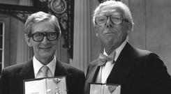 Comedy script writing partners Denis Norden and Frank Muir with their CBEs (PA)