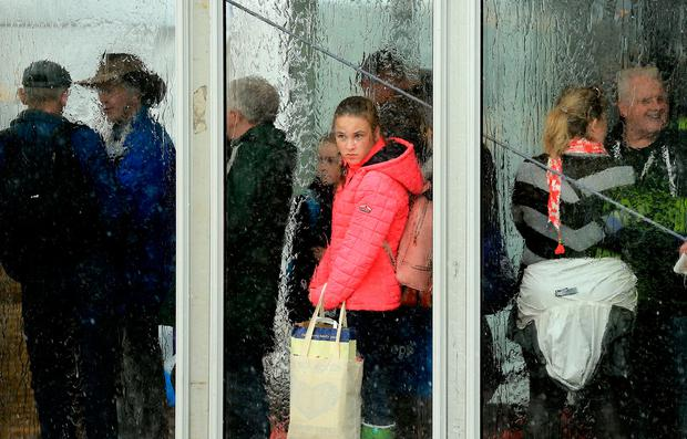 National Ploughing Championships 2018. People take cover from the torrential rain at the championships. Picture; Gerry Mooney