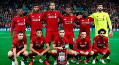 Liverpool line up prior to the Group C match of the UEFA Champions League between Liverpool and Paris Saint-Germain at Anfield