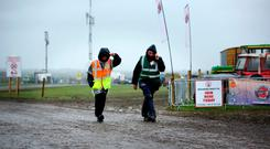 National Ploughing Championships 2018. Stewards Richard Sunders and Mark Kennedy make their way throufgh a deserted site as storm Ali arrives . Picture; Gerry Mooney