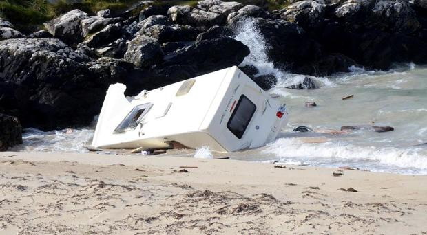 The caravan was swept into the sea this morning Photo: Paul Mealey