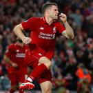Liverpool's James Milner celebrates scoring their second goal