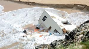 The scene in Claddaghduff in Galway where a Swiss tourist in her 50s was killed as her caravan was blown into the sea by Storm Ali Pic shows The caravan lying in the sea at Actons bneach campsite in Claddaghduff. Pic Paul Mealey