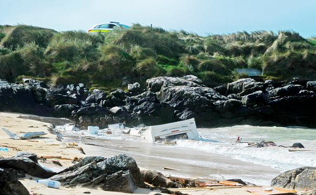 The wreckage from the Caravan that was washed into the sea from the Eco Camping site in Claddaghduff last night. Photo: Conor Mc Keown