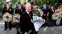 Show of force: Retired Sergeant Major Noel O'Callaghan with his grand-daughter Aleesha Penrose (9), at the parade for respect at Merrion Square, Dublin. Photo: Brian Lawless/PA Wire