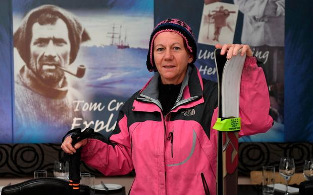 Folowing in his footsteps: Aileen Crean O'Brien in front of a picture of her grandfather in the Tom Crean Fish and Wine Restaurant in Kenmare. Photo: Domnick Walsh