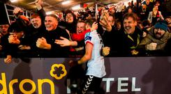 Daniel Kelly and Bohemians fans celebrate the team's second goal during their victory against Derry City last night. Photo: Stephen McCarthy/Sportsfile