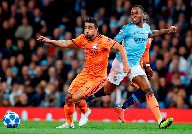 Manchester City's Raheem Sterling (right) and Lyon's Rafael battle for the ball. Photo: Martin Rickett/PA Wire