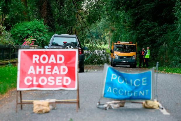 Tragedy: The road is closed at Slieve Gullion forest park, Co Down, where a worker died after being hit by a tree. Photo: PA