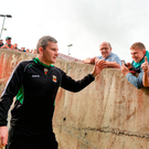 James Horan greets Mayo fans as he makes his way on to the Gaelic Grounds pitch ahead of the 2014 All-Ireland semi-final replay. Photo: Sportsfile