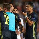 Cristiano Ronaldo of Juventus reacts after his red card during the Group H match of the UEFA Champions League between Valencia and Juventus at Estadio Mestalla on September 19, 2018 in Valencia, Spain. (Photo by Manuel Queimadelos Alonso/Getty Images)