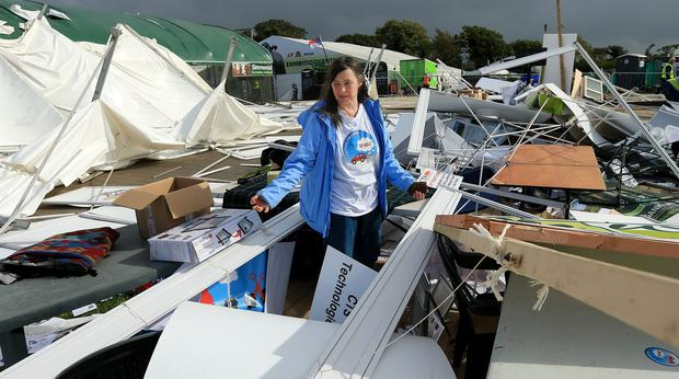 National Ploughing Championships 2018. Jane Jackson tries to clean up her stand in the exhibition site in Screggan after damage caused by Storm Ali . Picture; Gerry Mooney