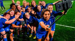 Leinster's Sene Naoupu takes a photo with team-mates and the cup after their Women's Interprovincial Championship victory over Munster last weekend. Photo: Sportsfile