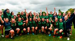 The Connacht team and coaches with the cup following the U-18 Girls Interprovincial Championship triumph. Photo: Barry Cregg/Sportsfile