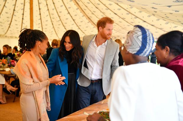 Meghan Markle, accompanied by Prince Harry, and her mother, Doria Ragland , welcomes the women behind the cookbook she has championed to Kensington Palace in London Photo: Ben Stansall/PA Wire