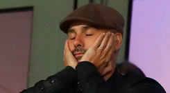 Eyes down: It was a frustrating night for Pep Guardiola as he watched Manchester City lose 2-1 against Lyon from the stands. Photo: PA