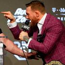 Conor McGregor talks to Khabib Nurmagomedov (not pictured)
