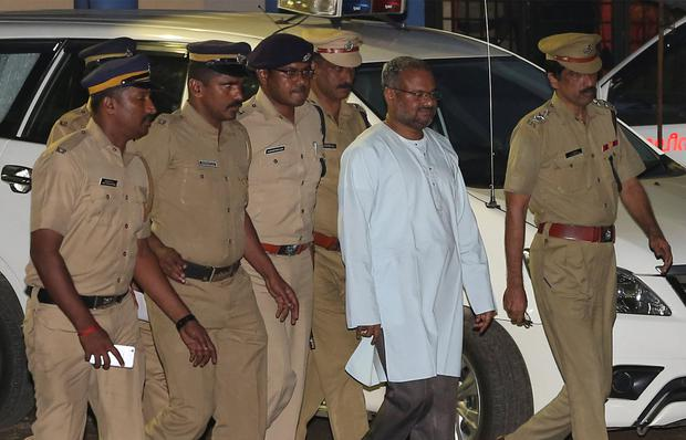 Bishop Franco Mulakkal, accused of raping a nun is escorted by police outside a crime branch office on the outskirts of Kochi in the southern state of Kerala India