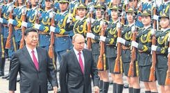 Closer: Russia's President Vladimir Putin reviews a military guard with Chinese President Xi Jinping (left) in Beijing in June. Photo: Greg Baker/Getty Images