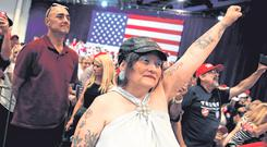 Standing together: Supporters of US President Donald Trump attend a campaign rally in Las Vegas, Nevada. Photo: Mike Segar/Reuters
