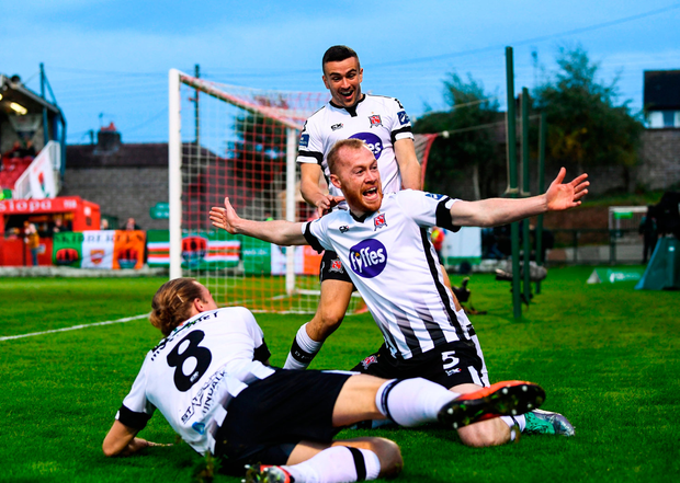 Chris Shields of Dundalk celebrates with team-mates John Mountney, 8, and Michael Duffy after scoring his side's first goal