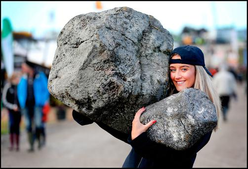 Hands full: Edel Mullane is all smiles at the Ploughing. Photo: Steve Humphreys