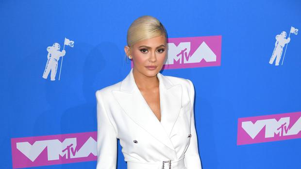 Kylie Jenner Wears PVC, & Baby Stormi's Silver Dress Will Slay You