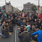 Protesters sitting on Dublin's O'Connell Bridge (Photo: Tony Gavin)