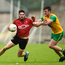 Connaire Harrison of Down in action against Leo McLoone of Donegal during the Ulster GAA Football Senior Championship Semi-Final match between Donegal and Down at St Tiernach's Park in Clones, Monaghan.