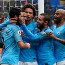 Manchester City's Riyad Mahrez celebrates scoring their fourth goal with team mates