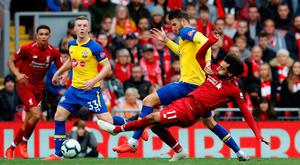 Liverpool's Mohamed Salah in action with Southampton's Wesley Hoedt