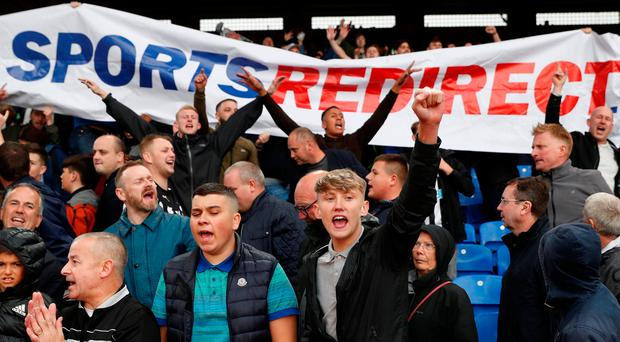 Newcastle fans protest against owner Mike Ashley after uninspiring goalless draw with Crystal Palace