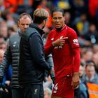 Liverpool's Virgil van Dijk with manager Jurgen Klopp after being substituted off due to injury