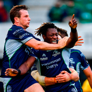 Niyi Adeolokun of Connacht, centre, celebrates with team-mates after scoring his side's third try during the Guinness PRO14 Round 4 match between Connacht and Scarlets at the Sportsground in Galway.