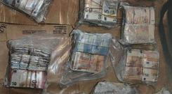 It is estimated that a total of €1.2 million euro was seized in relation to the three searches.