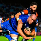 Devin Toner is tackled short of the try line by Edinburgh's Sean Kennedy last night. Photo: Sportsfile
