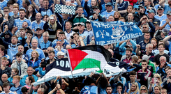 Palestinian flags are waved on Hill 16 at Croke Park during an All-Ireland Senior Football Championship match earlier this year. Photo: INPHO