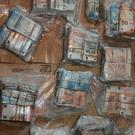CASH HAUL: Vacuum-packed bundles of €50 notes seized