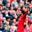 Mohamed Salah celebrates after scoring Liverpool's third goal during the Premier League victory over Southampton at Anfield yesterday. Photo: Getty Images
