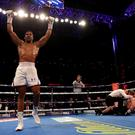LONDON, ENGLAND - SEPTEMBER 22: Anthony Joshua celebrates victory over Alexander Povetkin during the IBF, WBA Super, WBO & IBO World Heavyweight Championship title fight at Wembley Stadium (Photo by Richard Heathcote/Getty Images)