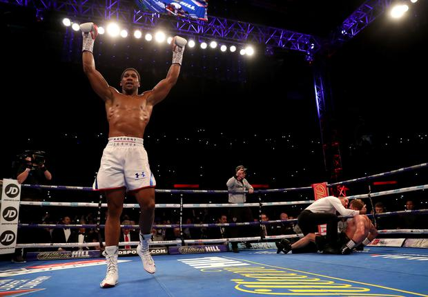 Champion Joshua stops plucky Povetkin at Wembley