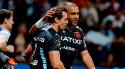 Racing92's Irish winger Simon Zebo celebrates with team mate after scoring a try during the French Top 14 rugby union match between Racing 92 and Castres