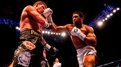 Anthony Joshua and Alexander Povetkin trade punches during the IBF, WBA Super, WBO & IBO World Heavyweight Championship title fight at Wembley Stadium