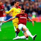 LONDON, ENGLAND - SEPTEMBER 23: Eden Hazard of Chelsea is tackled by Declan Rice of West Ham United during the Premier League match between West Ham United and Chelsea FC at London Stadium on September 23, 2018 in London, United Kingdom. (Photo by Dean Mouhtaropoulos/Getty Images)