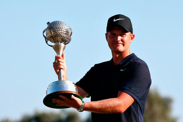 Tom Lewis poses with his trophy after claiming the Portugal Masters at the Dom Pedro Victoria GC. Photo: Jan Kruger/Getty Images