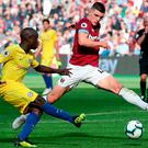 Declan Rice times his block tackle perfectly to foil Chelsea's N'Golo Kante. Photo credit: Tim Goode/PA Wire